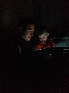 Jeff and Jack reading books by flashlight.